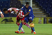 AFC Wimbledon defender Paul Kalambayi (30) battles for possession during the EFL Trophy group stage match between AFC Wimbledon and Stevenage at the Cherry Red Records Stadium, Kingston, England on 6 November 2018.