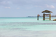 Gazebo over the water along Love beach in Nassau, Bahamas