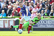 Forest Green Rovers Isaac Pearce(17) is bundled off the ball by Exeter City midfielder Jake Taylor (25) during the EFL Sky Bet League 2 match between Forest Green Rovers and Exeter City at the New Lawn, Forest Green, United Kingdom on 4 May 2019.