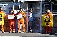 Roma, 8 ottobre 2006  .Manifestazione  di attivisti di Greenpeace davanti all' Ambasciata della Corea del Nord  per protestare contro i test nucleare e per consegnare una lettera di protesta di Greenpeace all'Ambasciatore.  .Il leader della Corea del Nord, Kim Jong-il, sta pianificando di testare armi nucleari nei prossimi giorni, in concomitanza con il 9 ° anniversario della sua leadership del paese..Un addetto dell' ambasciata non vuole essere fotografato.Rome October 8 th 2006      .Demonstration  of Greenpeace activists outside the North Korea embassy  to protest against the nuclear test and to deliver a letter of protest of Greenpeace  to the Ambassador.    .The North Korean leader, Kim Jong-il, is planning to test a nuclear weapon during the coming days, to coincide with the 9th anniversary of his leadership of the country.   .An employee of 'embassy does not want to be photographed