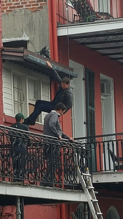 EXCLUSIVE<br /> Tom Cruise, hanging from a wire, practising a stunt while filimng &quot;Jack Reacher&quot; from a balcony at Chateau Hotel, New Orleans.<br /> &copy;Exclusivepix Media