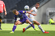 Shrewsbury Town midfielder (on loan from Chelsea) Luke McCormick (18) battles for possession  with Milton Keynes Dons midfielder Jordan Houghton (24) during the EFL Sky Bet League 1 match between Milton Keynes Dons and Shrewsbury Town at stadium:mk, Milton Keynes, England on 10 August 2019.