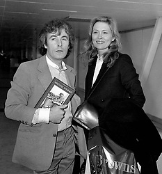 File photo dated 15/05/82 of photographer Terry O'Neill with American actress Faye Dunaway at Heathrow airport in London.