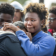 OXON HILL, MD-OCT20: Marshai Harper, 15, cries as she holds Imani Liverpool, 15,  at a press conference outside Potomac High School in Oxon Hill, MD, October 20, 2105, for her cousin Keyshaun Mason,14, who was stabbed to death by his mom's live-in boyfriend. During a domestic dispute, Lakisha Jenkins, was barricaded in the master bedroom of her home by her live-in boyfriend, 48-year-old Sean Crawford. Crawford was armed with a kitchen knife. Keyshaun Mason, 14, and his 18-year-old brother attempted to enter the master bedroom to ask Crawford to leave their home. According to the documents, Crawford then stabbed Keyshaun in the chest. Both teens were taken to a local hospital where Keyshaun was pronounced dead. His brother was treated at the hospital and released. (Photo by Evelyn Hockstein/For The Washington Post)