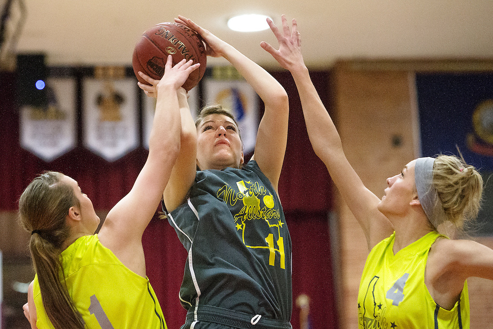 GABE GREEN/Press<br /> <br /> Priest River,s Jill Weimer shoots the ball as southern Idaho players attempt to block.