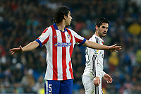 Real Madrid´s Isco (R) and Atletico de Madrid´s Tiago Cardoso during Spanish King´s Cup match at Santiago Bernabeu stadium in Madrid, Spain. January 15, 2015. (ALTERPHOTOS/Victor Blanco)