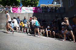 Hitec Products Cycling Team riders head back to the team bus after cheering on their teammates during Stage 5 of the Giro Rosa - a 12.7 km individual time trial, starting and finishing in Sant'Elpido A Mare on July 4, 2017, in Fermo, Italy. (Photo by Balint Hamvas/Velofocus.com)