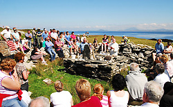 Pilgrims to Caher Island soaked up the glorious sunshine as Fr Karl Burns from Westport celebrated mass during the annual pilgrimage to the Island on sunday...Pic Conor McKeown
