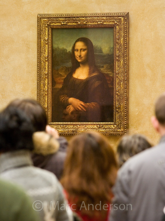 Crowds of people around the famous Mona Lisa painting in The Louvre museum, Paris, France.