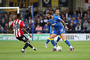 AFC Wimbledon defender Callum Kennedy (23) taking on Brentford midfielder Josh Clarke (20) during the EFL Cup match between AFC Wimbledon and Brentford at the Cherry Red Records Stadium, Kingston, England on 8 August 2017. Photo by Matthew Redman.