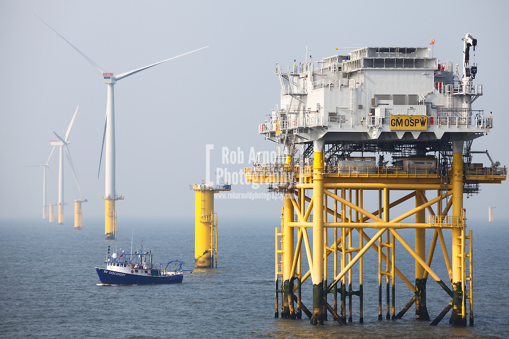 © Rob Arnold.  28/03/2014. North Wales, UK. Survey vessel, RV Discovery, passing the west substation on the Gwynt y Môr Offshore Wind Farm off the coast of North Wales. Photo credit : Rob Arnold