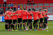 York City huddle before the Sky Bet League 2 match between Stevenage and York City at the Lamex Stadium, Stevenage, England on 12 September 2015. Photo by Simon Davies.