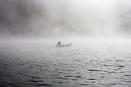 © 2007 Randy Vanderveen, all rights reserved.Jasper National Park, Alberta.A boater motors his way through the morning fog on Maligne Lake.