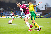 Burnley defender Matthew Lowton (2) challenged by the opponent during the The FA Cup match between Burnley and Norwich City at Turf Moor, Burnley, England on 25 January 2020.