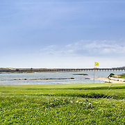 Algarve golf course seascape scenery, at Ria Formosa wetlands reserve, famous golf and nature destination, southern Portugal.