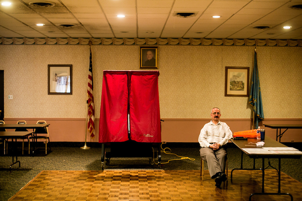 BAYONNE, NJ - JUNE 6, 2016: A poll worker waits inside a slow polling place at the Catholic War Veterans post in Bayonne, New Jersey. CREDIT: Sam Hodgson for The New York Times.