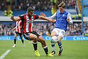 Sheffield United striker Leon Clarke (9) and Sheffield Wednesday midfielder Adam Reach (20) during the EFL Sky Bet Championship match between Sheffield Wednesday and Sheffield Utd at Hillsborough, Sheffield, England on 24 September 2017. Photo by Phil Duncan.