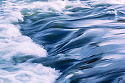 A tongue of glassy smooth water enters Big Eddy rapid on the Deschutes River, near Bend, Oregon.