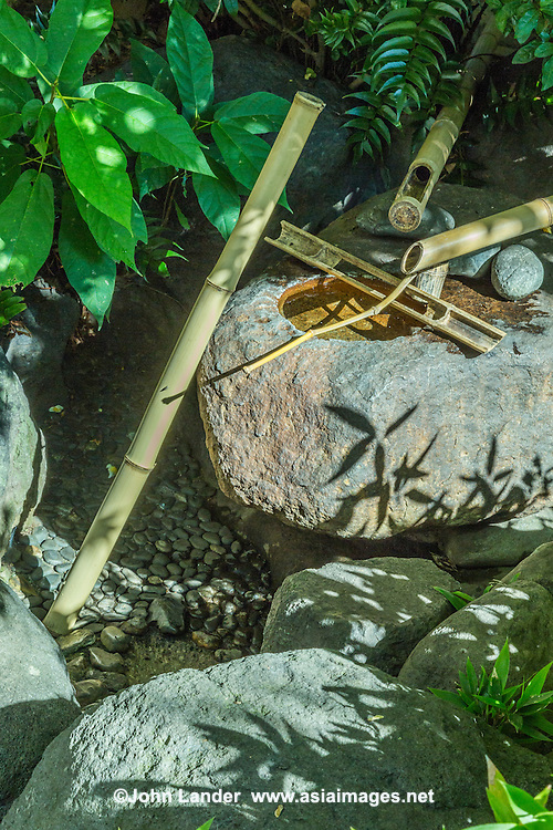 "Suikinkutusu is a Japanese garden ornament and a sound producing device.  Also known as a ""water harp"" it is commonly part of a chozubachi, a place for washing the hands at a temple garden or before tea ceremony.  In the past these contraptions were called tosuimon.  The sound is made when water drops into the cavern below, reflecting on the enclosed jar underneath and creates a water echo effect such as in a cave."