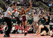 Westerville North coach David Grant and father Lou Demas leap out of their seats as Josh Demas defeats Lakewood St. Edward's Nick Sulzer in the 152-pound class during the Division I finals of the state wrestling tournament at Ohio State's Schottenstein Center on March 7.