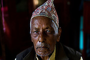 6th May 2015, Kathmandu, Nepal.  Ram Bahadur Puri (92) in his home in Puri village, near Kathmandu, on the 6th May 2015.<br /> <br /> He lived through the last major earthquake to hit Nepal 81 years ago in 1934. He was tending cows in the fields when the earthquake struck, they ran away in panic and later made their own way home. He was outside his house chatting with his wife and neighbours when the 2015 earthquake hit, he stood chanting the name of God until it subsided. His house was left in ruins.<br /> <br /> An earthquake with magnitude 7.8 occurred near Lamjung, Nepal, 50 miles northeast of the capital Kathmandu at 06:11:26 UTC on Apr 25, 2015. The capital has seen considerable devastation including the nine-story Dharahara Tower, one of Kathmandu's landmarks built by Nepal's royal rulers as a watchtower in the 1800s and a UNESCO-recognised historical monument. It was reduced to rubble and there were reports of people trapped. Portions of historic buildings in the World Heritage gazetted site of Patan have also been destroyed as well as many buildings in the old city. <br /> <br /> PHOTOGRAPH BY AND COPYRIGHT OF SIMON DE TREY-WHITE<br /> <br /> + 91 98103 99809<br /> email: simon@simondetreywhite.com<br /> photographer in delhi
