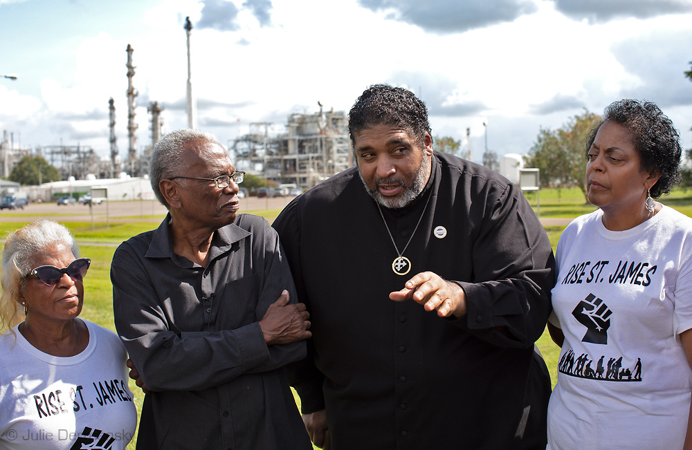 Sharon Lavigne, founder of Rise St. James, Robert Taylor, and Rev. .Barbar in front of the Denka/DuPont plant with members of the black and white community that live in Cancer Alley.