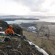 Freyr Ingi Björnsson and Sveinn Eydal at the top of the ice climb 55° at Búahamrar, Reykjavík, Iceland.