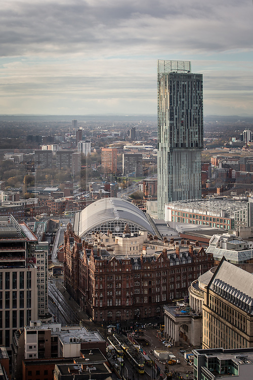 © Licensed to London News Pictures . 07/12/2013 . Beetham Tower , Midland Hotel , GMex , railway Station , Manchester Central , Central library , St Peters Square . Cityscape view of Manchester . Photo credit : Joel Goodman/LNP