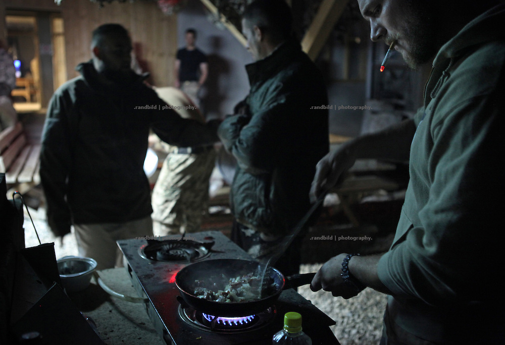 Soldiers in the District Headquarters near Nawabad cook dinner by mixing different NATO Ready-to-Eat Meals. In late October 2011 Kunduz based 3.Task Force started a several days operation in and around Nawabad (District Chahar Darah), west of Kunduz, northern Afghanistan. During the Operation Orpheus about 100 german infantery soldiers rolled out for patrols through the town and surrounding areas, which were expected as a retreat zone of insurgents.