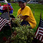 BRONX, NY - 8/18/2018 - Chief Select Hospital Corpsman<br /> Marchant Da Silva poses for a photos while cleaning up the yard at Samuel H. Young American Legion Post 620 on Saturday. U.S. Navy Chief Selects from Navy Operational Support Center New York volunteered as part of CPO 365 Phase II.  (U.S. Navy Photo by Chief  Mass Communication Specialist Roger S. Duncan / RELEASED )