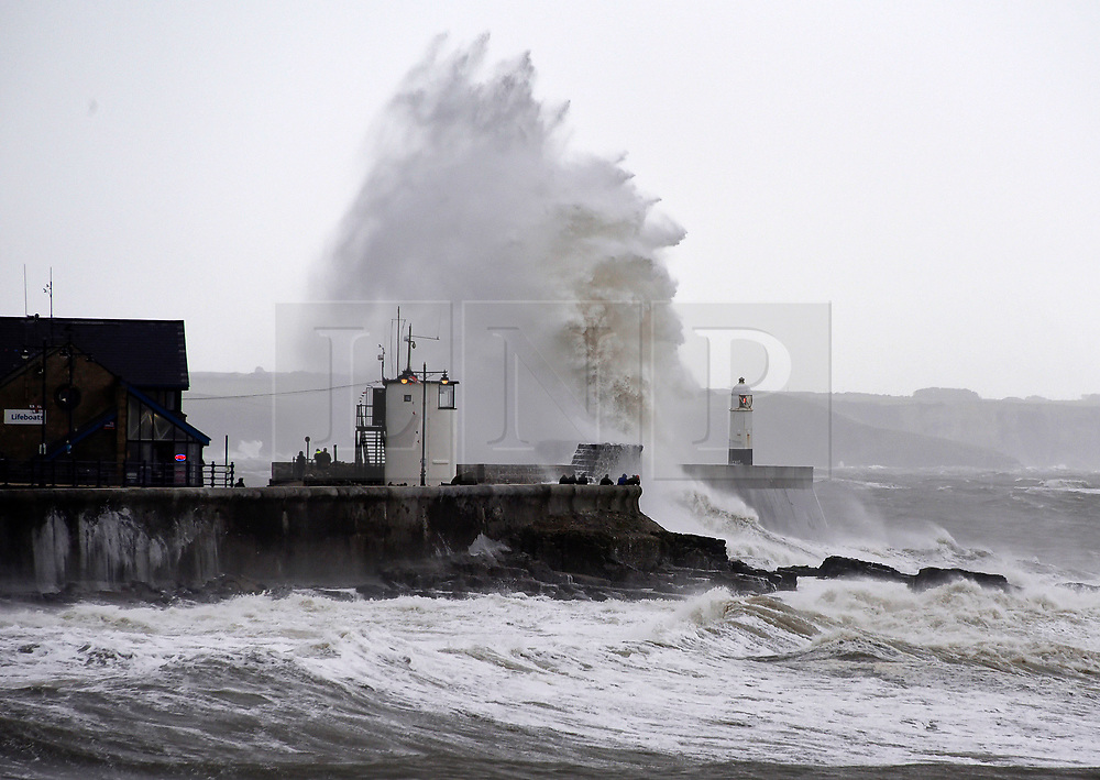 © Licensed to London News Pictures. 04/10/2019. Porthcawl, UK. Large waves hit the harbour wall as Storm Lorenzo, named after ex-hurricane Lorenzo, by Met Éireann, hits the Welsh seaside resort of Porthcawl in Bridgend, UK. Photo credit: Graham M. Lawrence/LNP