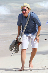 Ellen DeGeneres and Portia De Rossi take a stroll on Saint Jean beach after lunch at the Eden Rock restaurant in Saint Barthelemy island on December 25, 2015. Photo by ABACAPRESS.COM    528444_023 St Barthelemy France