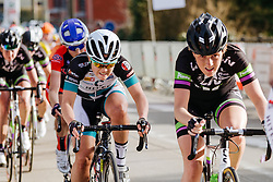 Emily Moberg grits her teeth as the peloton attempt to reel in Heather Fischer.