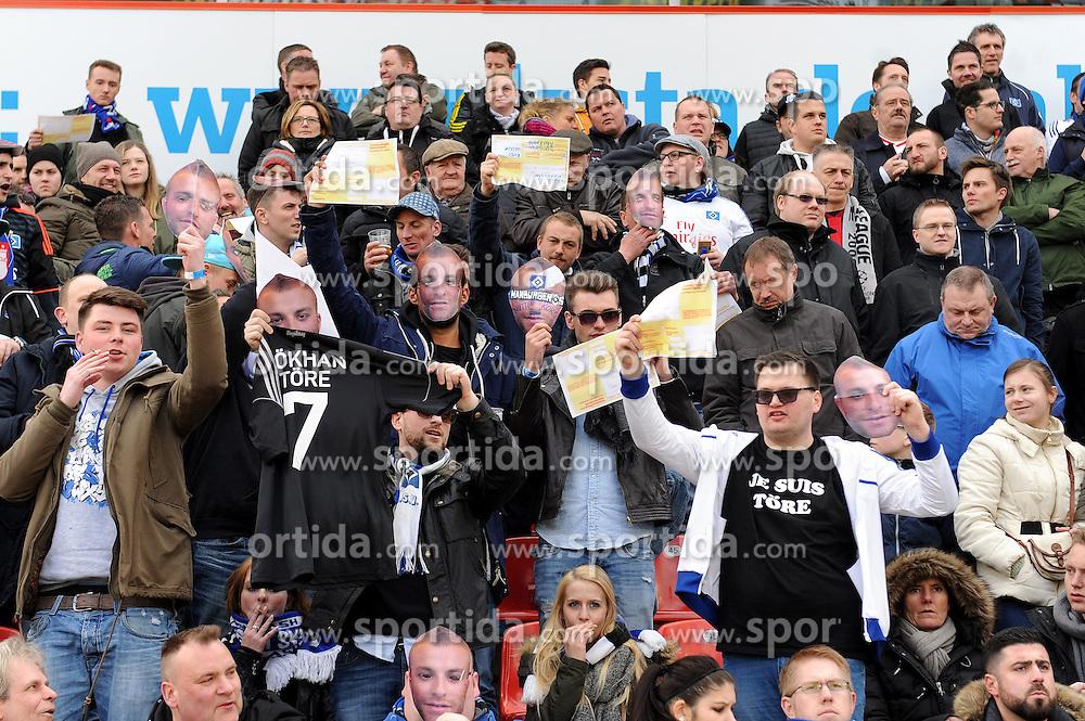 04.04.2015, BayArena, Leverkusen, GER, 1. FBL, Bayer 04 Leverkusen vs Hamburger SV, 27. Runde, im Bild In Anspielung auf den unruehmlichen Abgang von Hakan Calhanoglu ( nicht im Bild Bayer 04 Leverkusen ) halten Fans des Hamburger SV, Krankenscheine, AU Meldungen sowie Gesichtsbilder von Goekhan Toere hoch. // during the German Bundesliga 27th round match between Bayer 04 Leverkusen and Hamburger SV at the BayArena in Leverkusen, Germany on 2015/04/04. EXPA Pictures &copy; 2015, PhotoCredit: EXPA/ Eibner-Pressefoto/ Thienel<br /> <br /> *****ATTENTION - OUT of GER*****