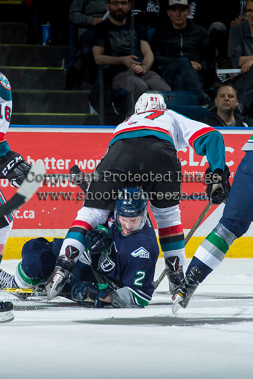 KELOWNA, CANADA - APRIL 25: Austin Strand #2 of the Seattle Thunderbirds lays on the ice beneath Calvin Thurkauf #27 of the Kelowna Rockets during first period  on April 25, 2017 at Prospera Place in Kelowna, British Columbia, Canada.  (Photo by Marissa Baecker/Shoot the Breeze)  *** Local Caption ***