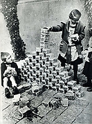 Hyperinflation of German currency, 1923. The depreciation in value of money made paper notes so worthless that children used them as building blocks.