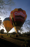 Sri Lanka..On the front lawn of a fruit farm home, two balloons get ready for take off. Near Dambulla.