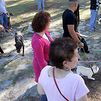 People listen to service during the St. Frances Day Blessing of the Animals Sunday October 5, 2014 at Hugh McRae Park in Wilmington, N.C. The event was sponsored by Good Shepherd Church. (Jason A. Frizzelle)
