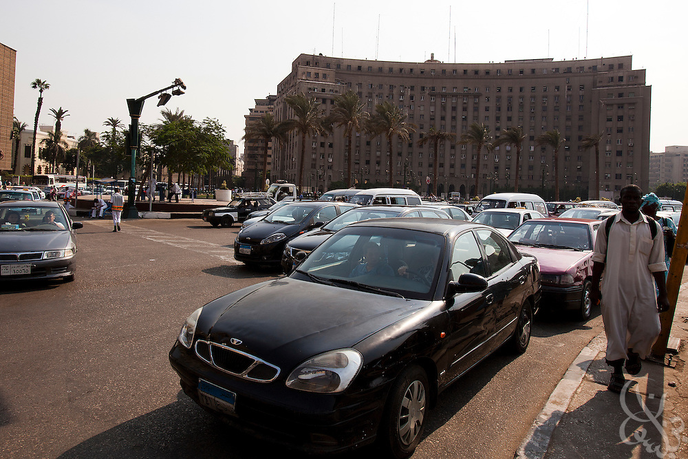 Traffic flows past the civic Mogamma building in Tahrir Square in central Cairo September 27, 2011. The building, which houses numerous government offices, is viewed as a corner stone of Egyptian bureaucracy.  (Photo by Scott Nelson)