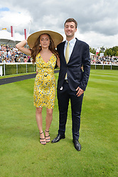 LILY ATKINSON and MICHAEL ROY at the Qatar Goodwood Festival - Ladies Day held at Goodwood Racecourse, West Sussex on 30th July 2015.