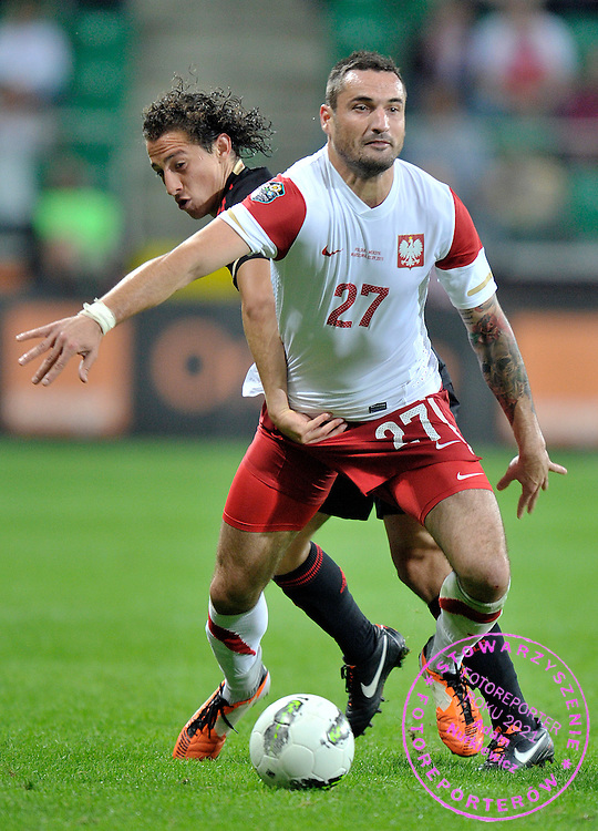 (L) Andres Guardado of Mexico & (R) Marcin Wasilewski of Poland fight for the ball during friendly soccer match between Poland and Mexico at Pepsi Arena in Warsaw, Poland...Poland, Warsaw, September 2, 2011..Picture also available in RAW (NEF) or TIFF format on special request...For editorial use only. Any commercial or promotional use requires permission...Photo by Adam Nurkiewicz / Mediasport