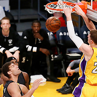 15 November 2016: Los Angeles Lakers center Timofey Mozgov (20) dunks the ball over Brooklyn Nets center Brook Lopez (11) during the LA Lakers 125-118 victory over the Brooklyn Nets, at the Staples Center, Los Angeles, California, USA.