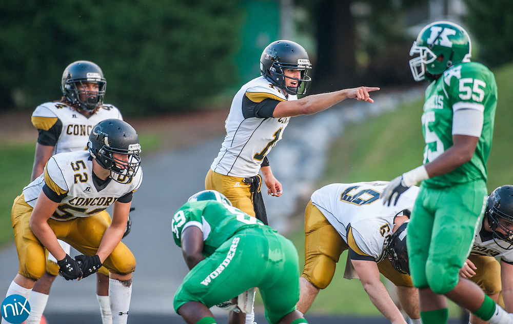 Concord quarterback Graham Pruette reads the defense against Kannapolis during the annual Battle of the Bell game Friday night at Kannapolis Memorial Stadium. Concord won the game 33-20 to keep the bell.