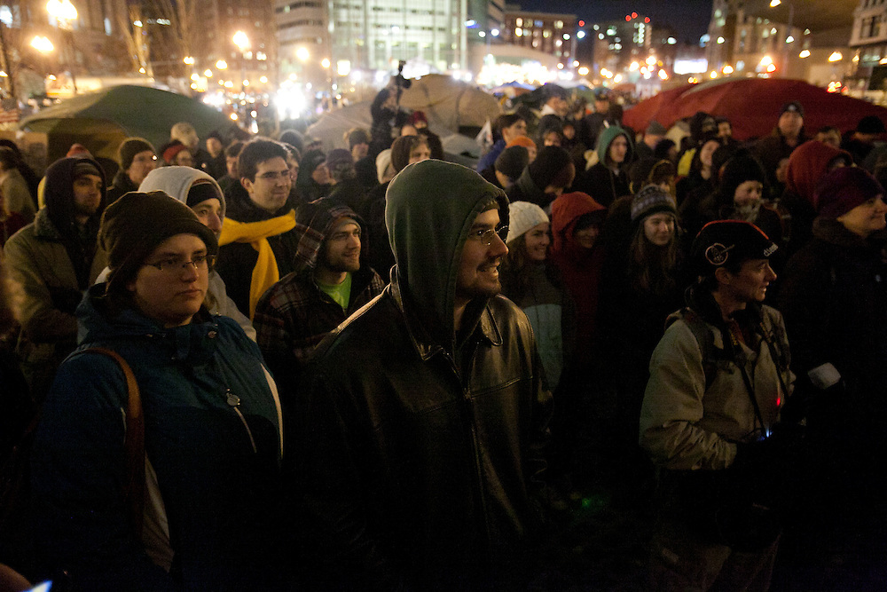 Boston, MA 12/08/2011.Occupy Boston members watch the  General Assembly on Thursday evening as the city's deadline to vacate Dewey Square draws near..Alex Jones / www.alexjonesphoto.com