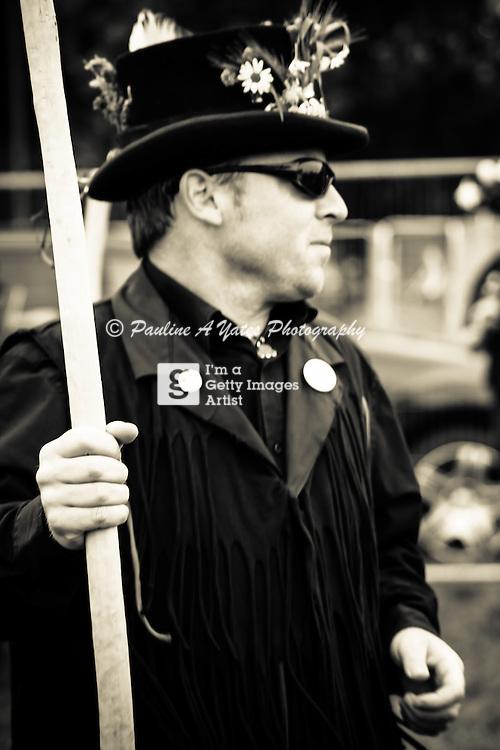 A Morris Man prepares for action at Strawberry Fair, Midsummer Common, Cambridge