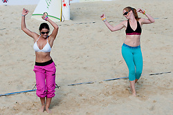 Viktorija Manzinni (Slovenian Playboy girl - playmate 2011) and Jelena Izlakar at Beachmaster 2011 tournament for Slovenian BeachTour on July 22, 2011, in Ptuj, Slovenia. (Photo by Matic Klansek Velej / Sportida)