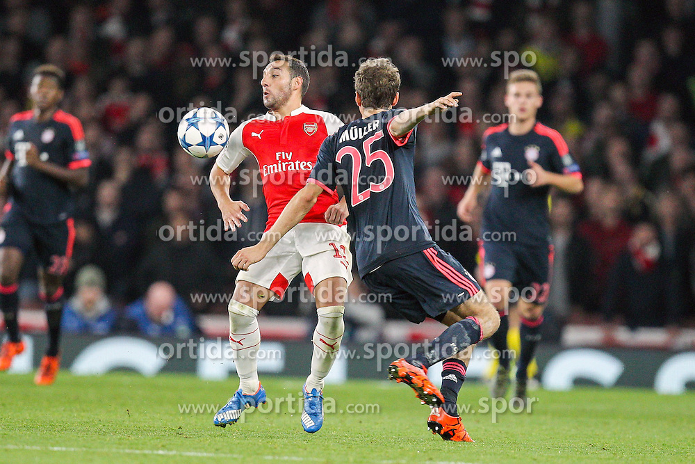 20.10.2015, Emirates Stadium, London, ENG, UEFA CL, FC Arsenal vs FC Bayern Muenchen, Gruppe F, im Bild l-r: Santi Cazorla #19 (FC Arsenal London) und Thomas Mueller #25 (FC Bayern Muenchen) // during UEFA Champions League group F match between Arsenal FC and FC Bayern Munich at the Emirates Stadium in London, Great Britain on 2015/10/20. EXPA Pictures &copy; 2015, PhotoCredit: EXPA/ Eibner-Pressefoto/ Kolbert<br /> <br /> *****ATTENTION - OUT of GER*****