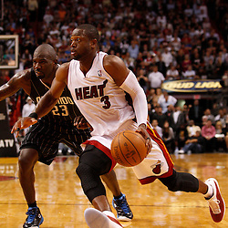 March 3, 2011; Miami, FL, USA; Miami Heat shooting guard Dwyane Wade (3) drives past Orlando Magic shooting guard Jason Richardson (23) during the fourth quarter at the American Airlines Arena. The Magic defeated the Heat 99-96.    Mandatory Credit: Derick E. Hingle