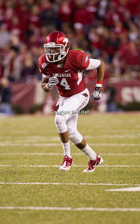 Nov 5, 2011; Fayetteville, AR, USA;  Arkansas Razorback wide receiver Jarius Wright (4) runs through a play during a game against the South Carolina Gamecocks at Donald W. Reynolds Stadium.  Mandatory Credit: Beth Hall-US PRESSWIRE