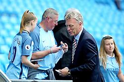 Sunderland manager David Moyes signs autographs for fans - Mandatory by-line: Matt McNulty/JMP - 13/08/2016 - FOOTBALL - Etihad Stadium - Manchester, England - Manchester City v Sunderland - Premier League